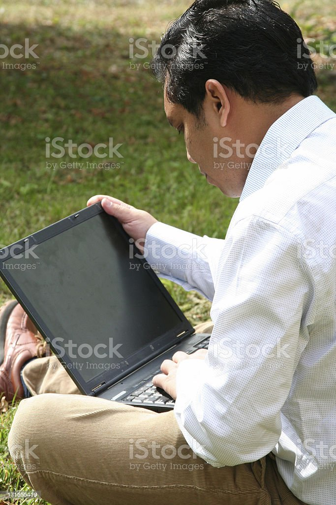 man concentrate working on his laptop royalty-free stock photo