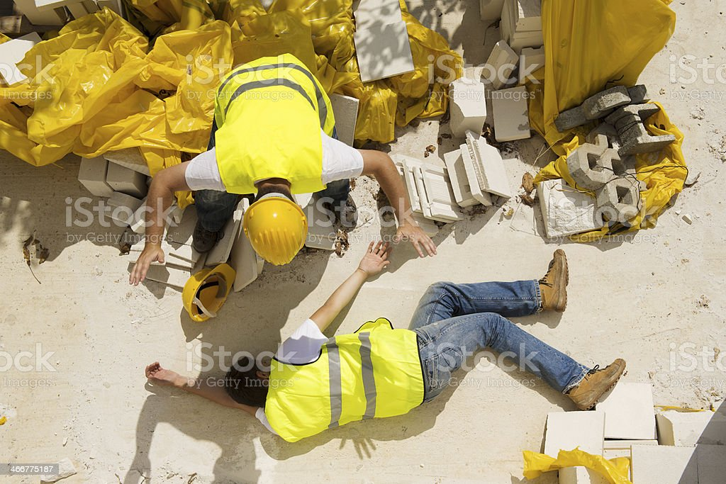 A man concerned at a construction accident stock photo