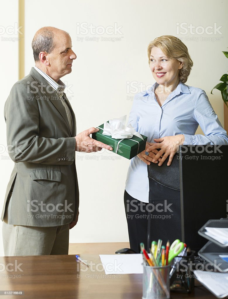 man congratulating colleague stock photo