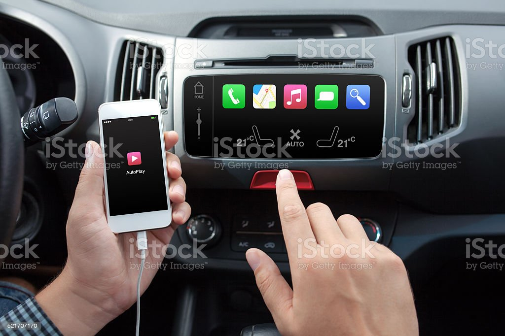 man connecting phone to the car media system stock photo