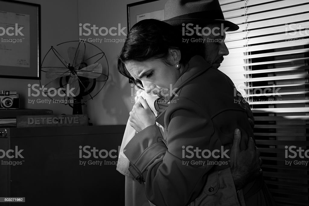 Man consoling a young woman in his office stock photo