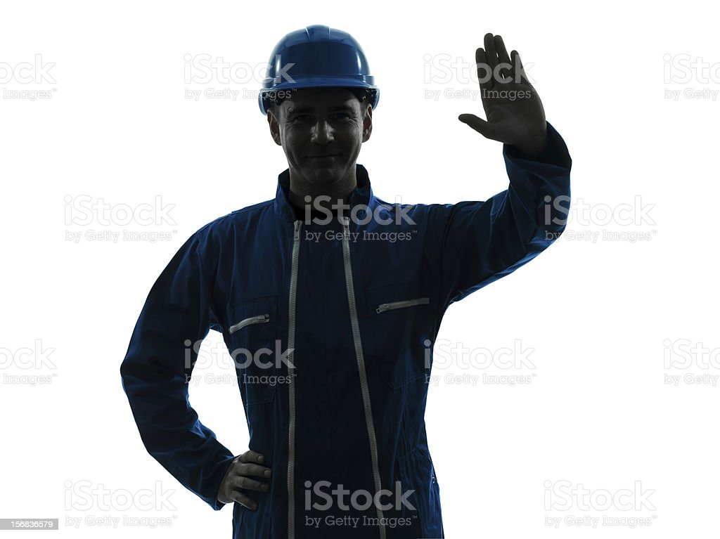 man construction worker saluting silhouette portrait royalty-free stock photo