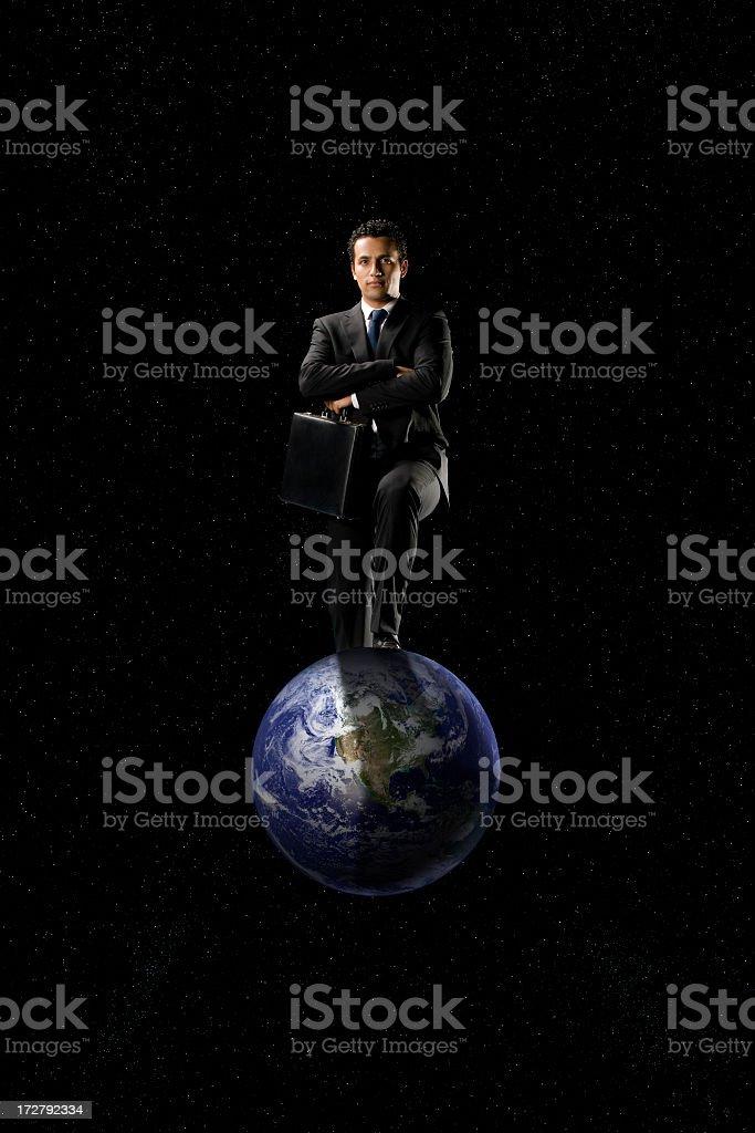 Man controling the world royalty-free stock photo