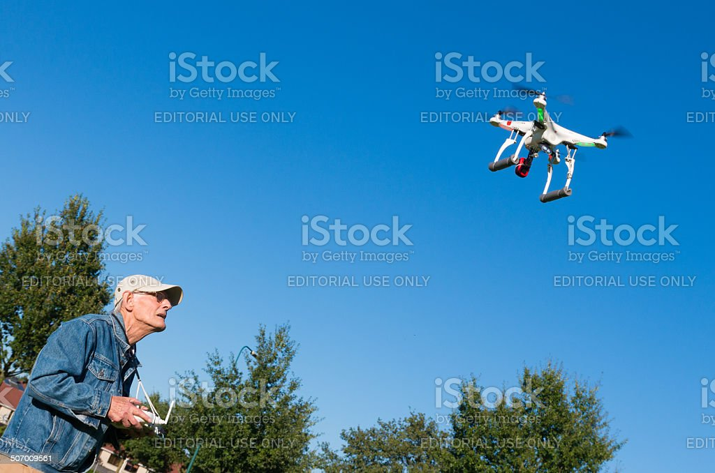 man controlling a drone stock photo