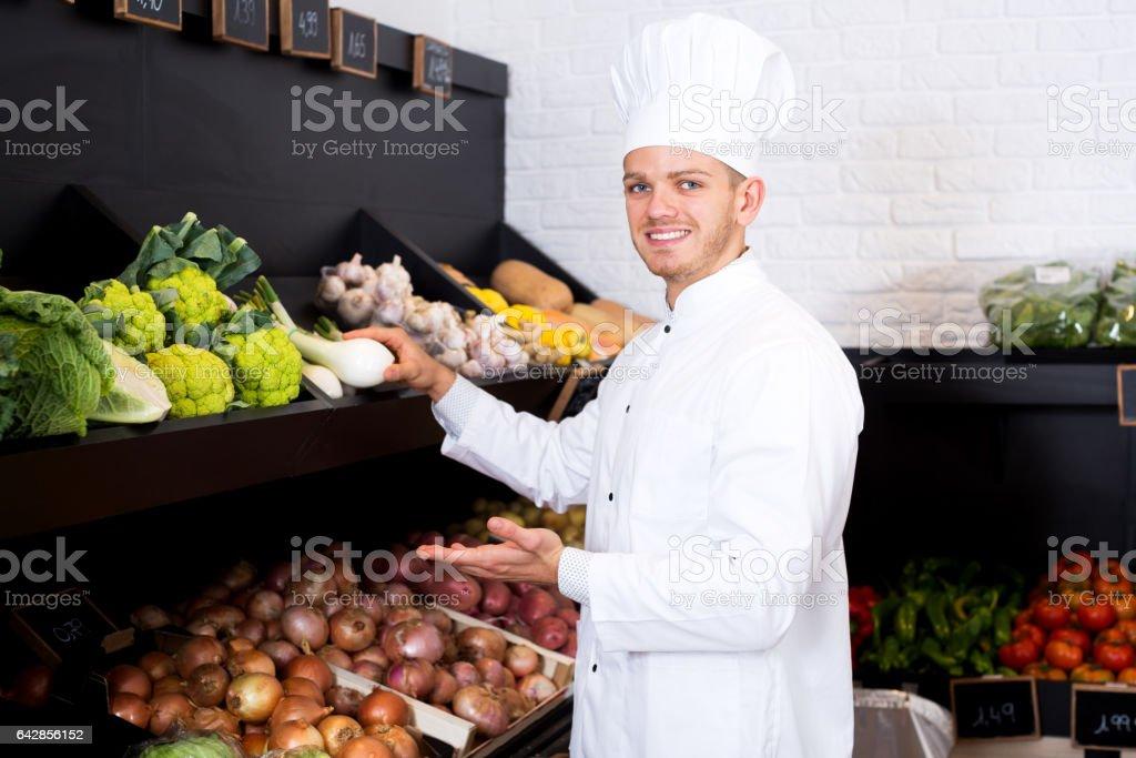 Man cook deciding on best vegetables stock photo