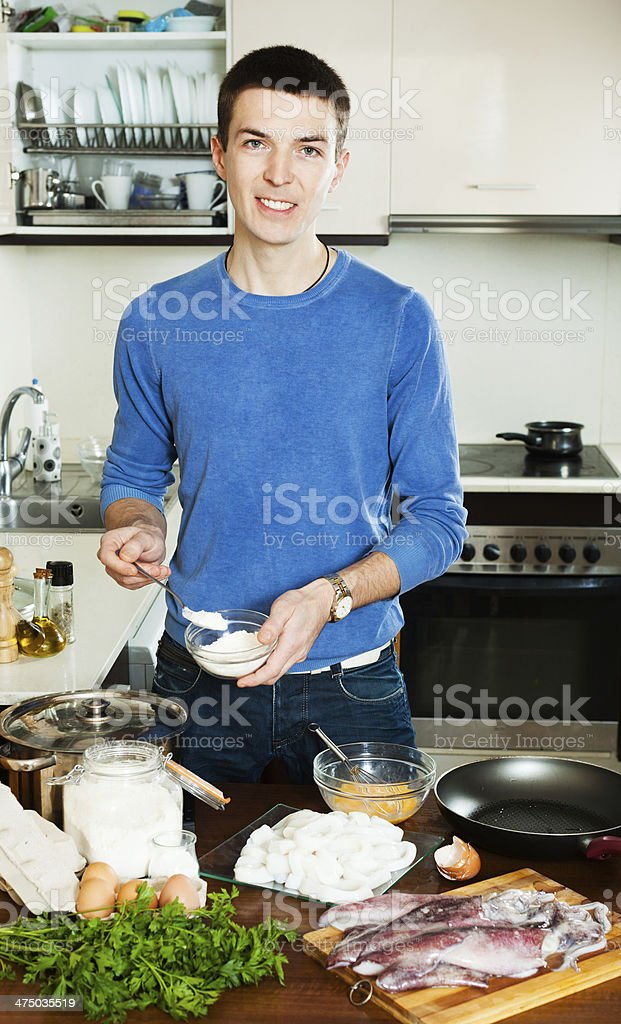 Man cooking frying squid rings royalty-free stock photo