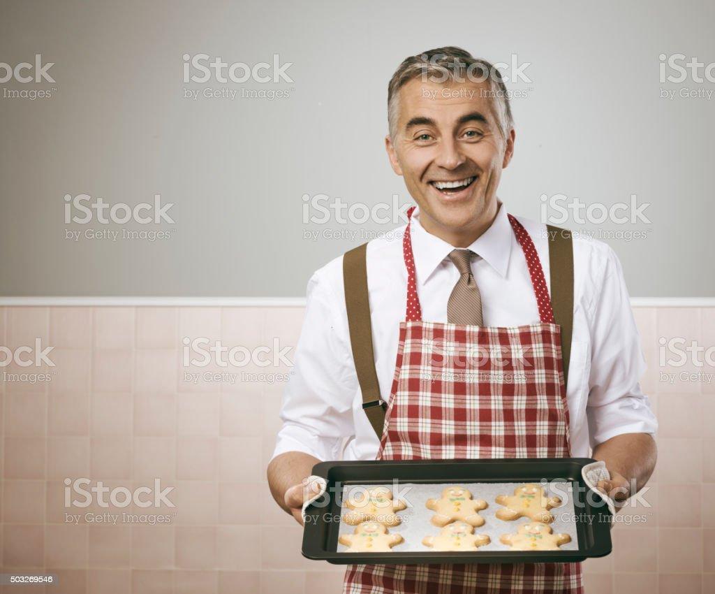 Man cooking gingerbread men stock photo