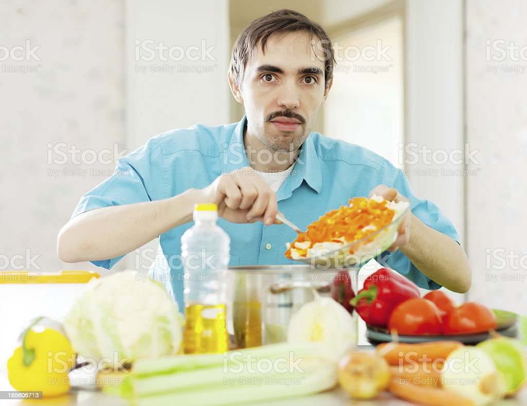 man cooking   in domestic kitchen royalty-free stock photo