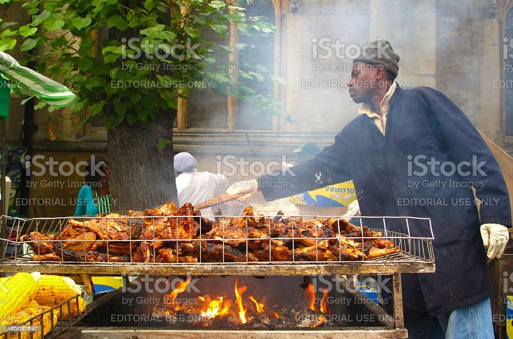 Man cooking jerk chicken at Notting Hill Carnival in London stock photo