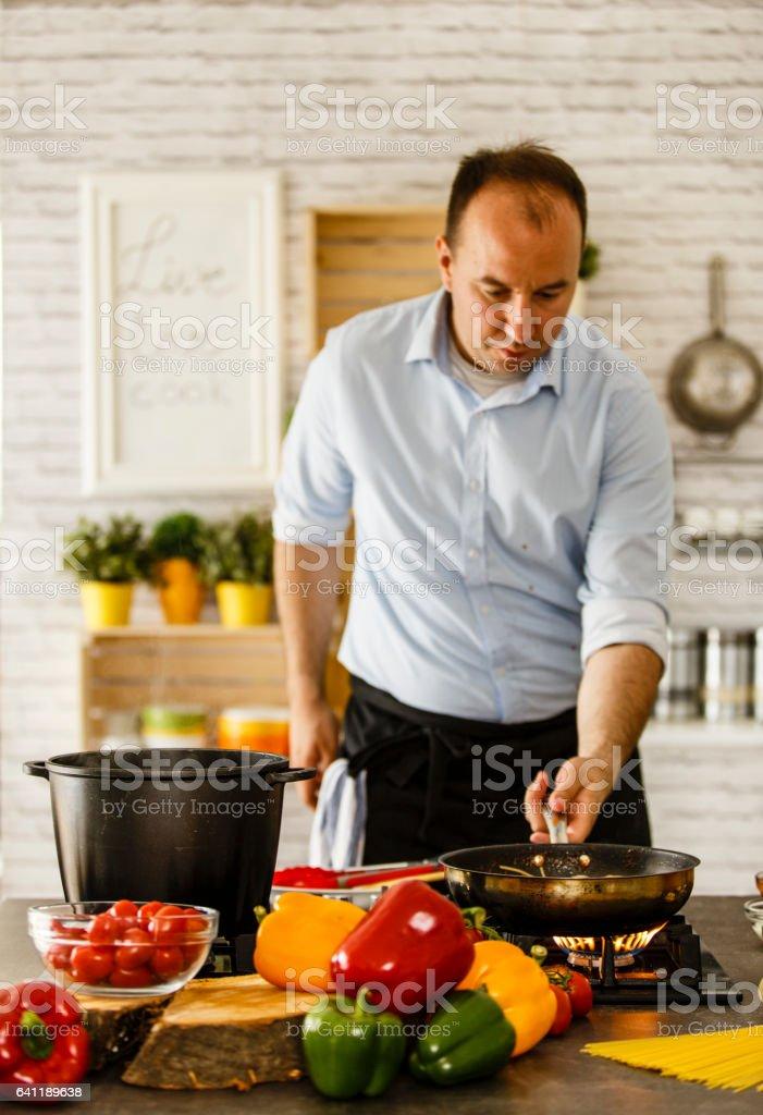 Man cooking stock photo