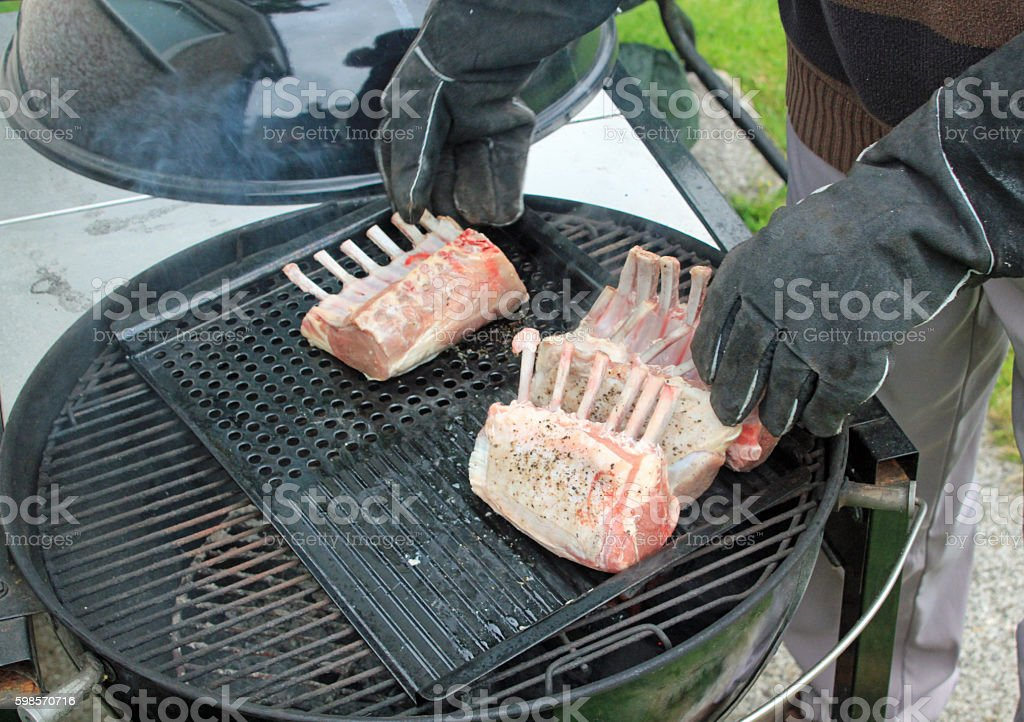 Man cooking racks of ribs on the BBQ stock photo