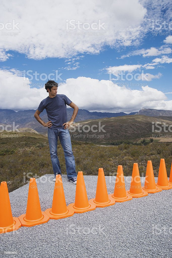 Man cornered by a row of safety cones royalty-free stock photo