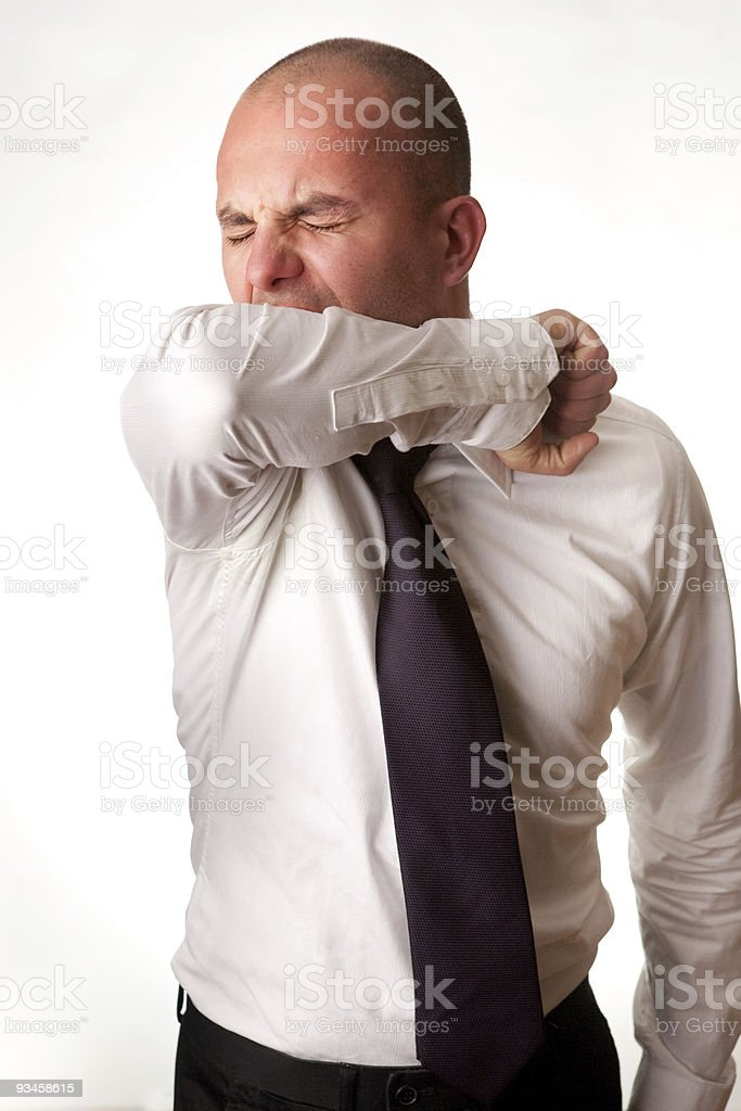 Man Coughing into Arm/Elbow royalty-free stock photo