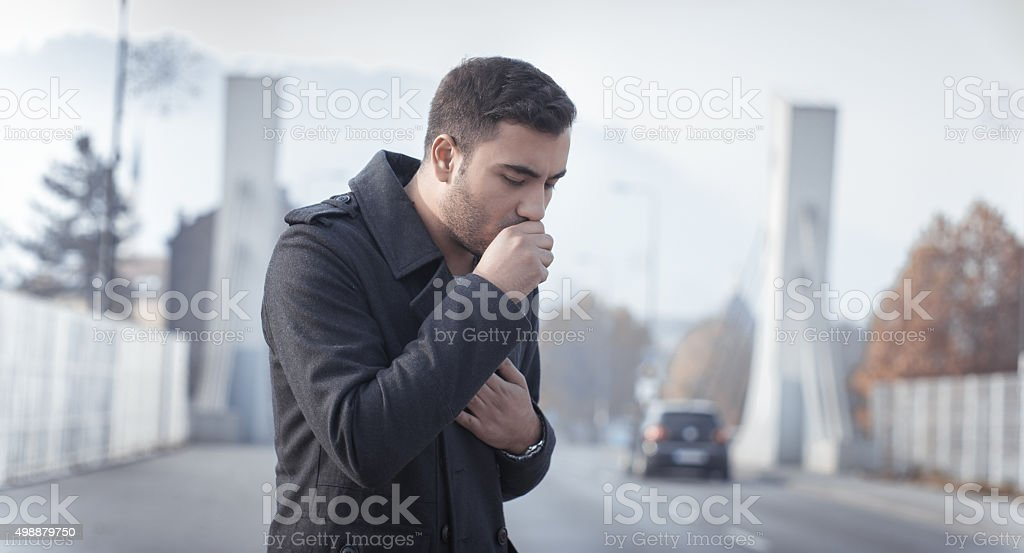 Man coughing stock photo