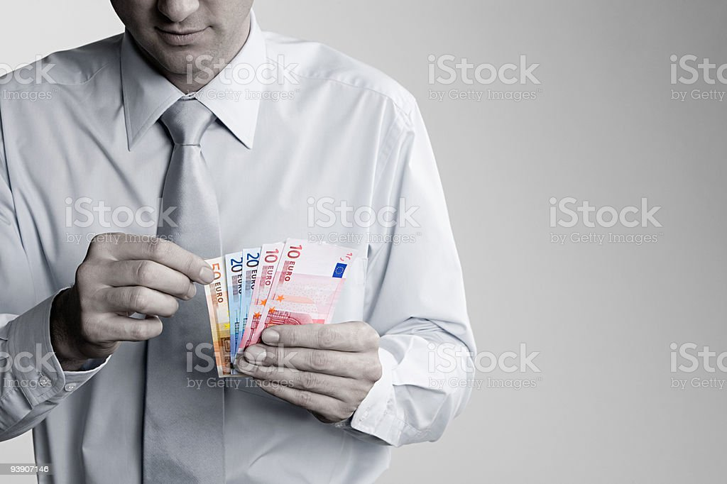 Man counting euro notes stock photo