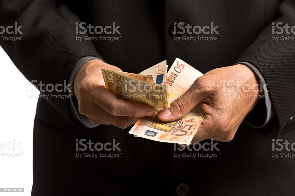 Man Counting European Currency, the Euros Close-up stock photo