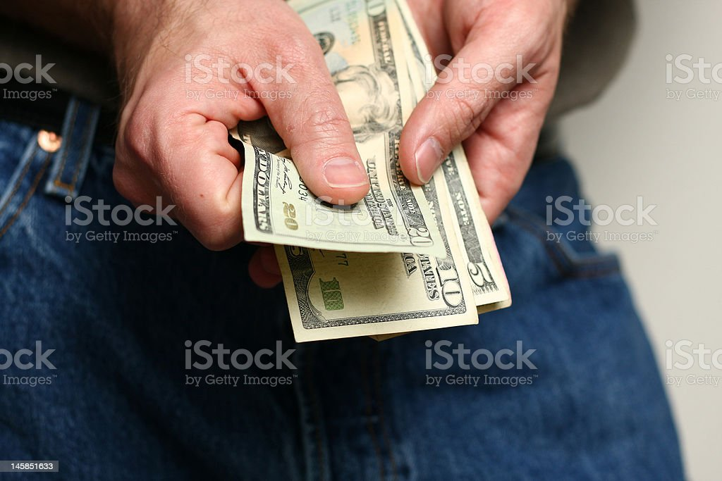 Man counting US dollars royalty-free stock photo