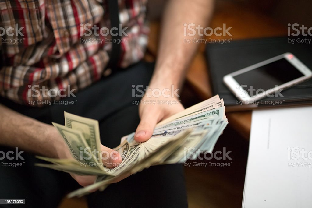 man counting usa dollars stock photo