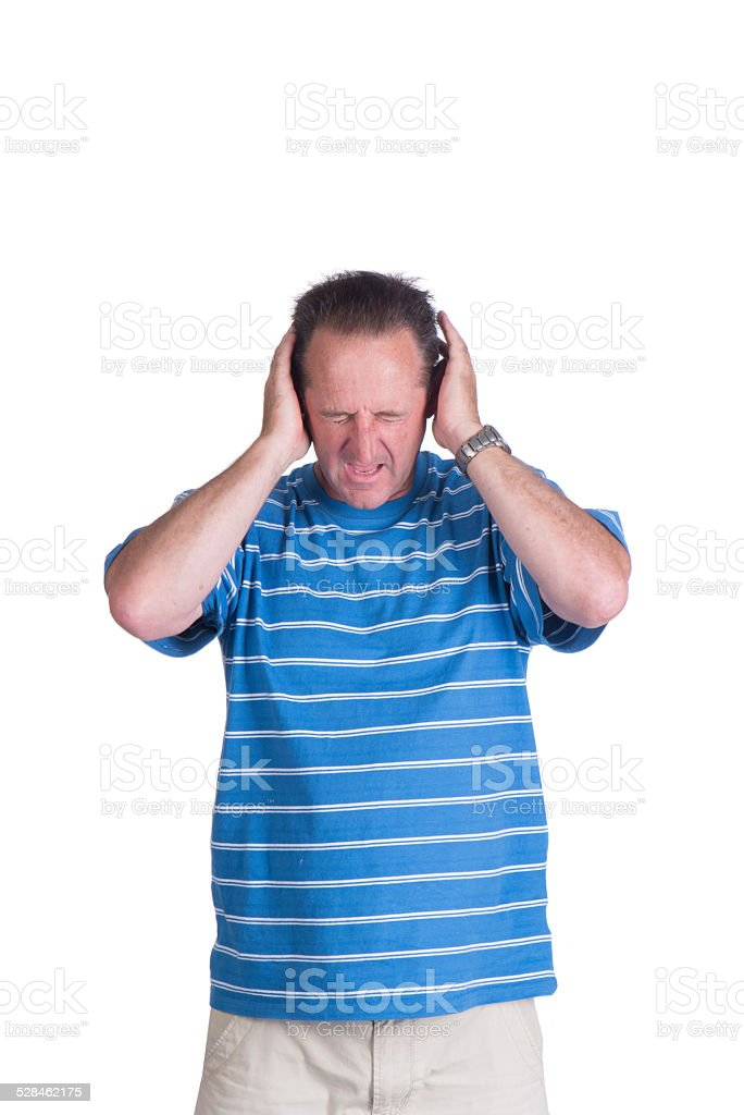 man coveing ears in pain stock photo