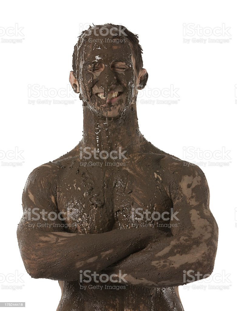 Man covered with mud and smiling royalty-free stock photo