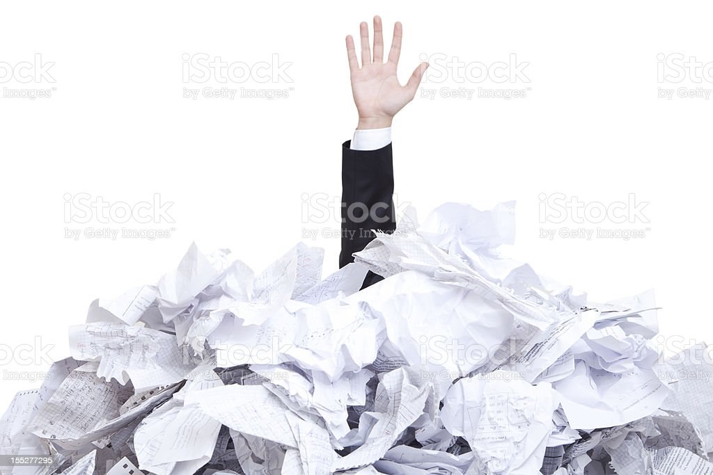 A man covered with tones of torn paper  royalty-free stock photo
