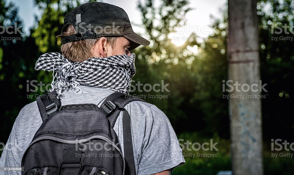 Man covering face with a scarf stock photo