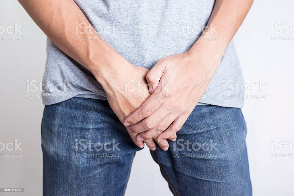 Man Covering His Crotch: Isolated Background stock photo