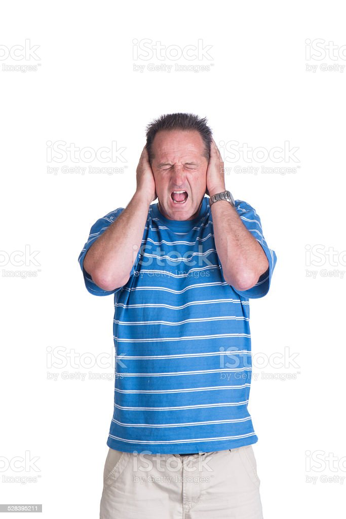 man covering his ears and screaming stock photo