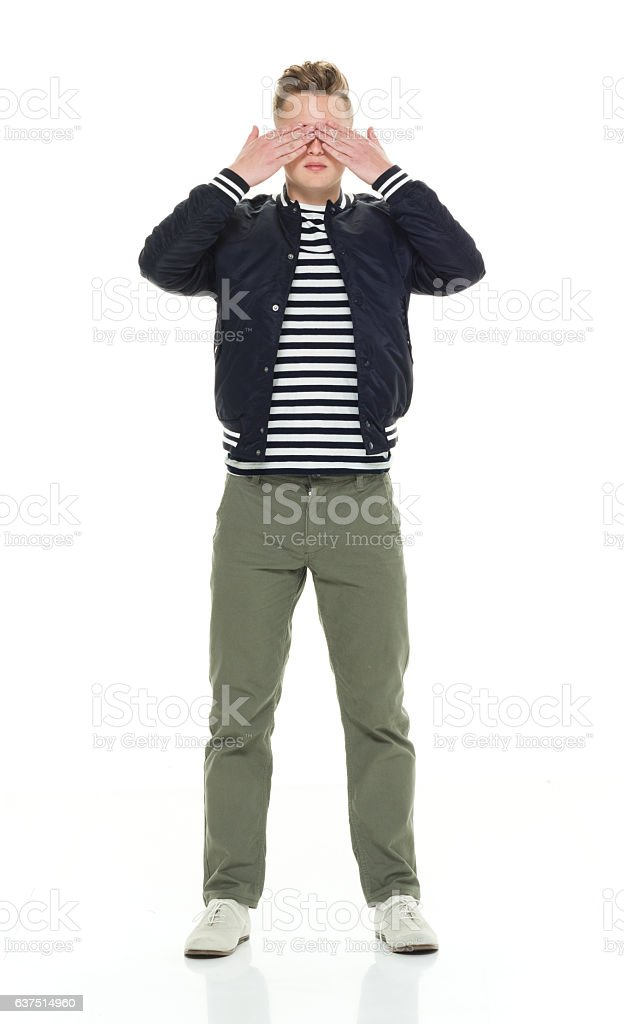 Man covering his eyes stock photo