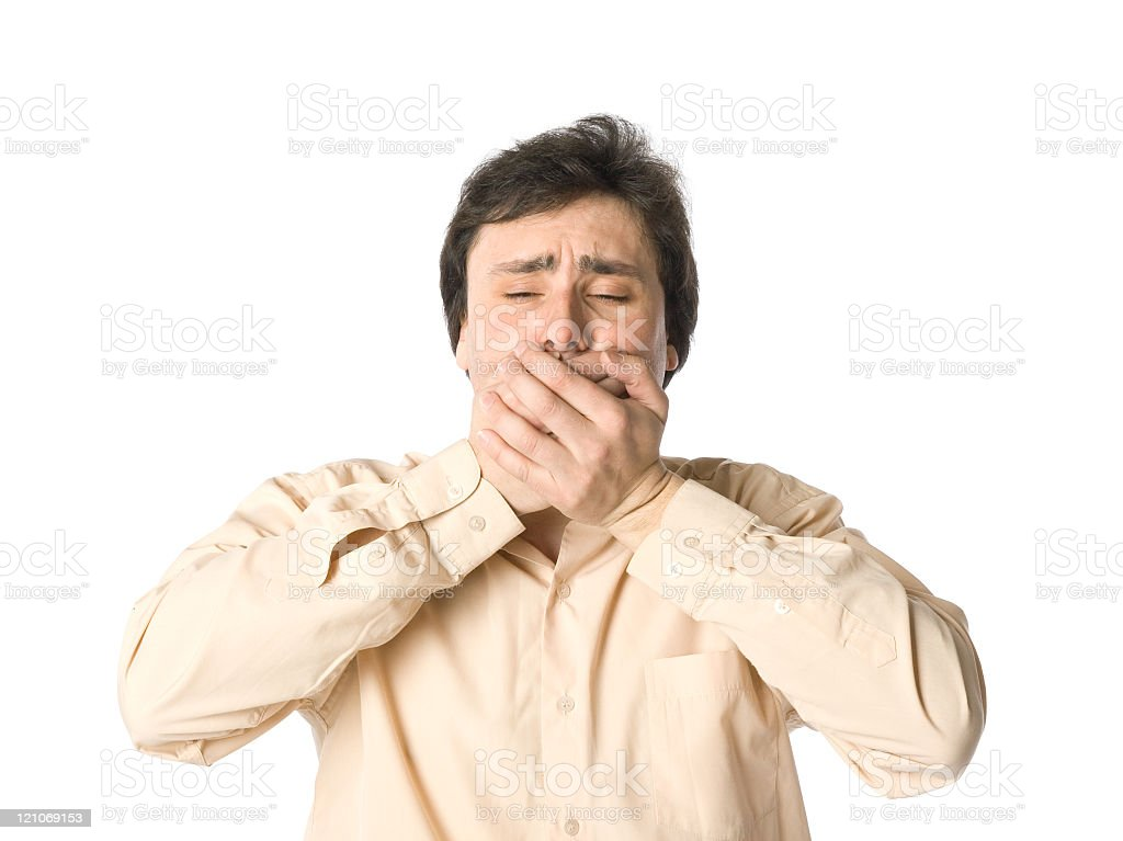 A man covering his mouth from blurting out a secret stock photo
