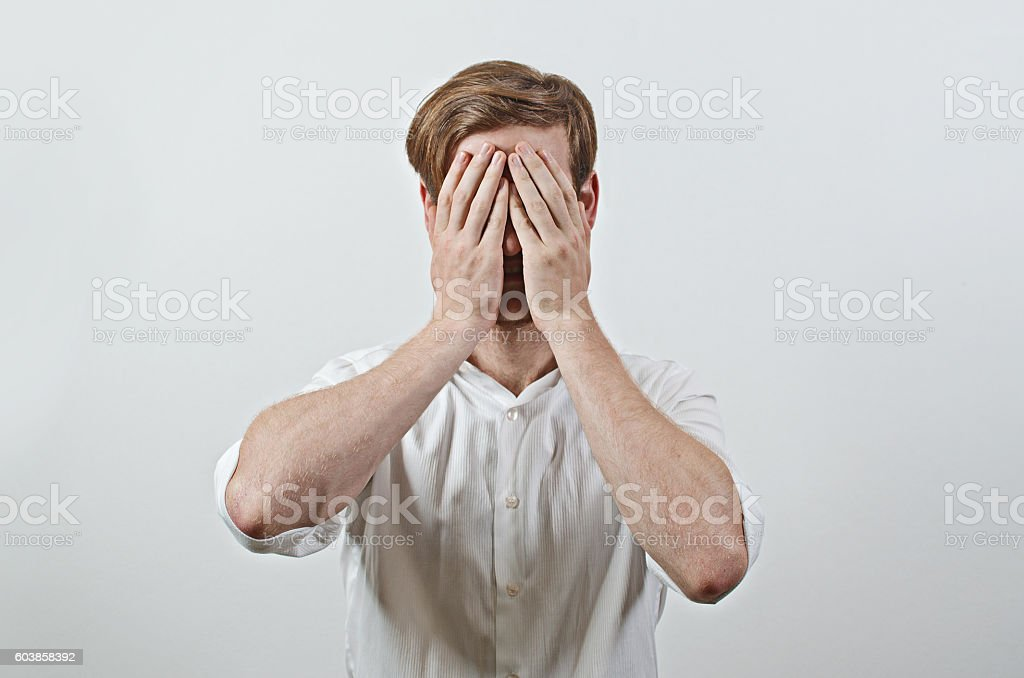 Man Covers His Face by Hand stock photo