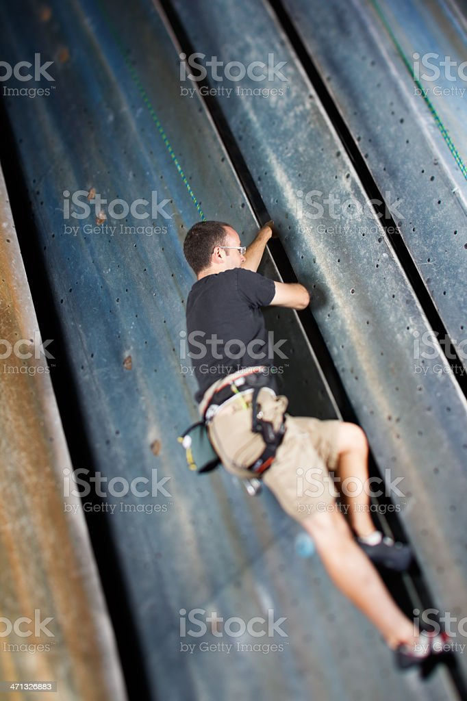 Man Crack Climbing stock photo