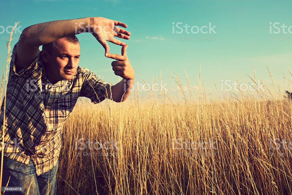Man creates a frame with hands stock photo