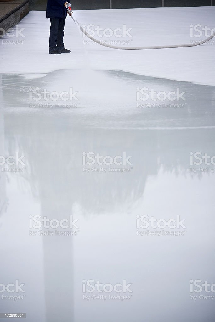 Man creating an ice rink surface royalty-free stock photo