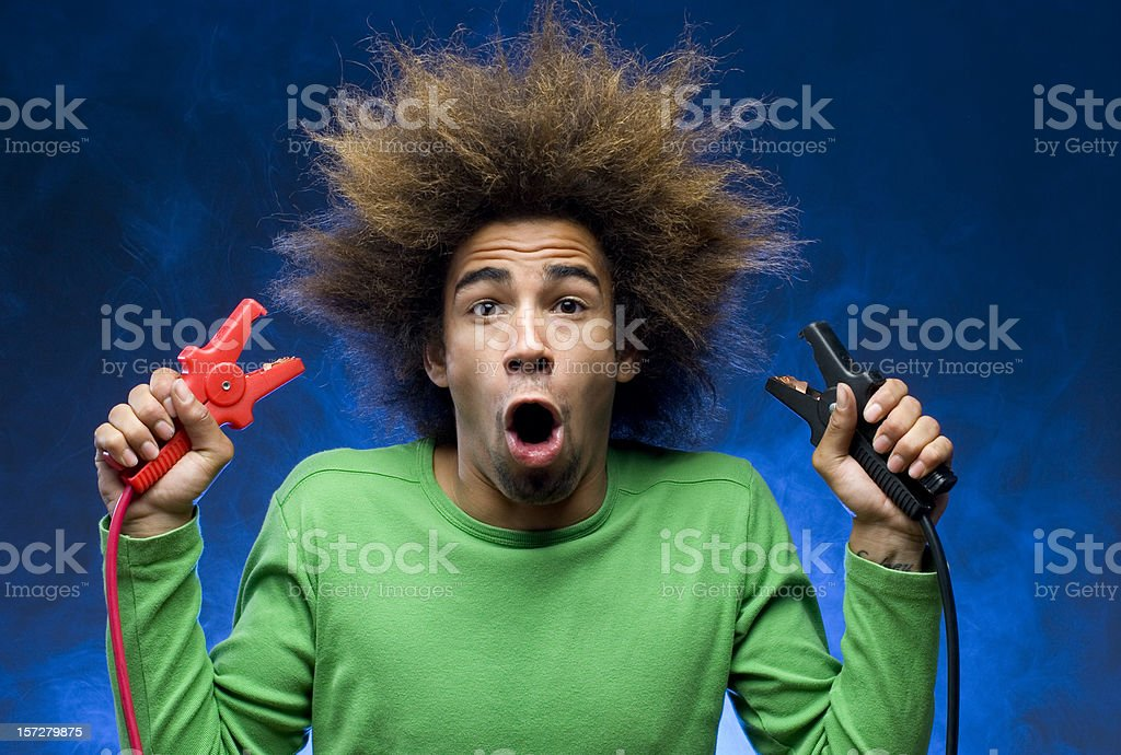 man creating short circuit causing smoke royalty-free stock photo
