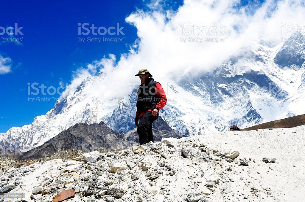 Man crests snowy peak on Everest stock photo