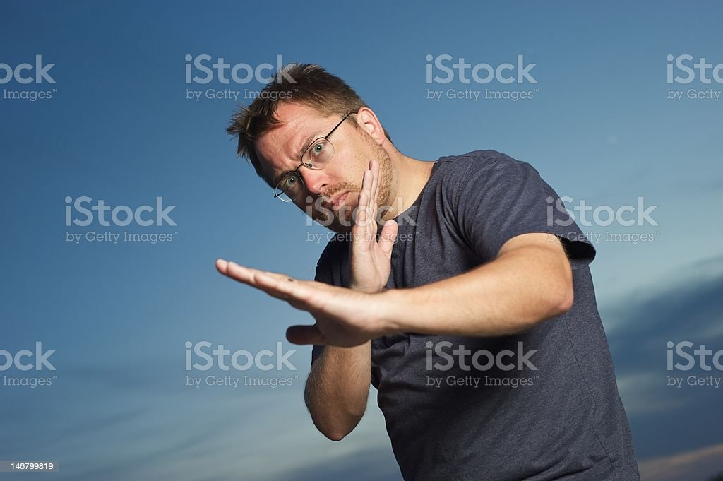 Man Crosses Arms in Combat stock photo