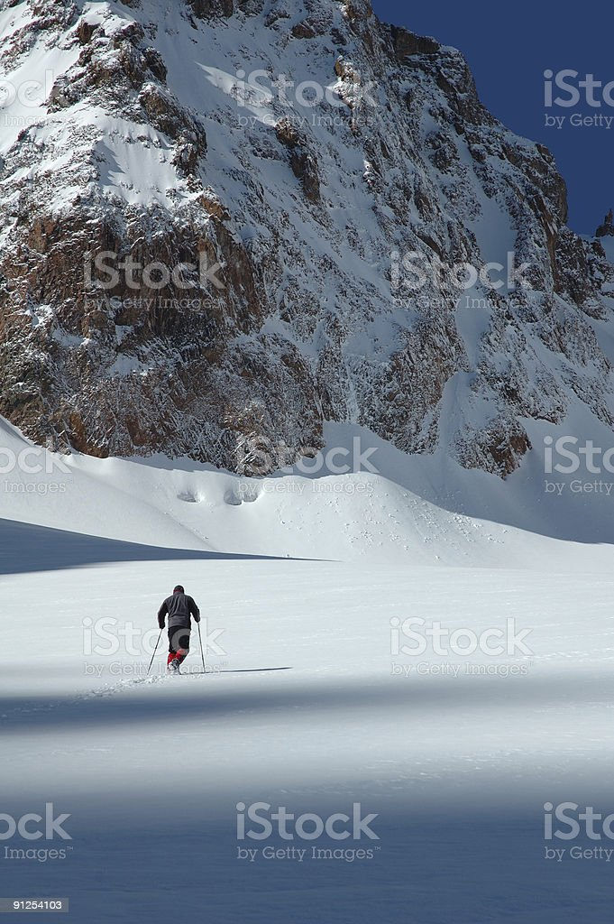 man crossing a glacier royalty-free stock photo