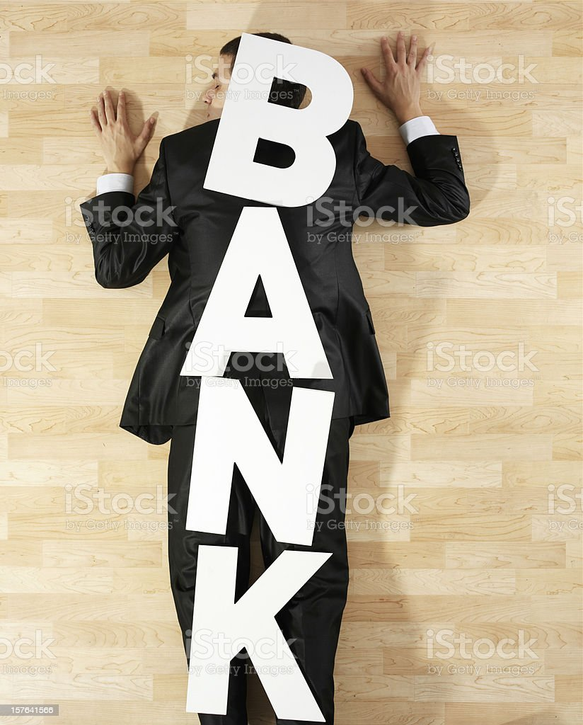 Man crushed by bank stock photo