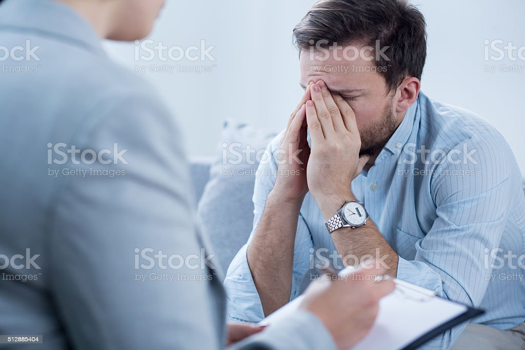 Man crying during psychotherapy stock photo