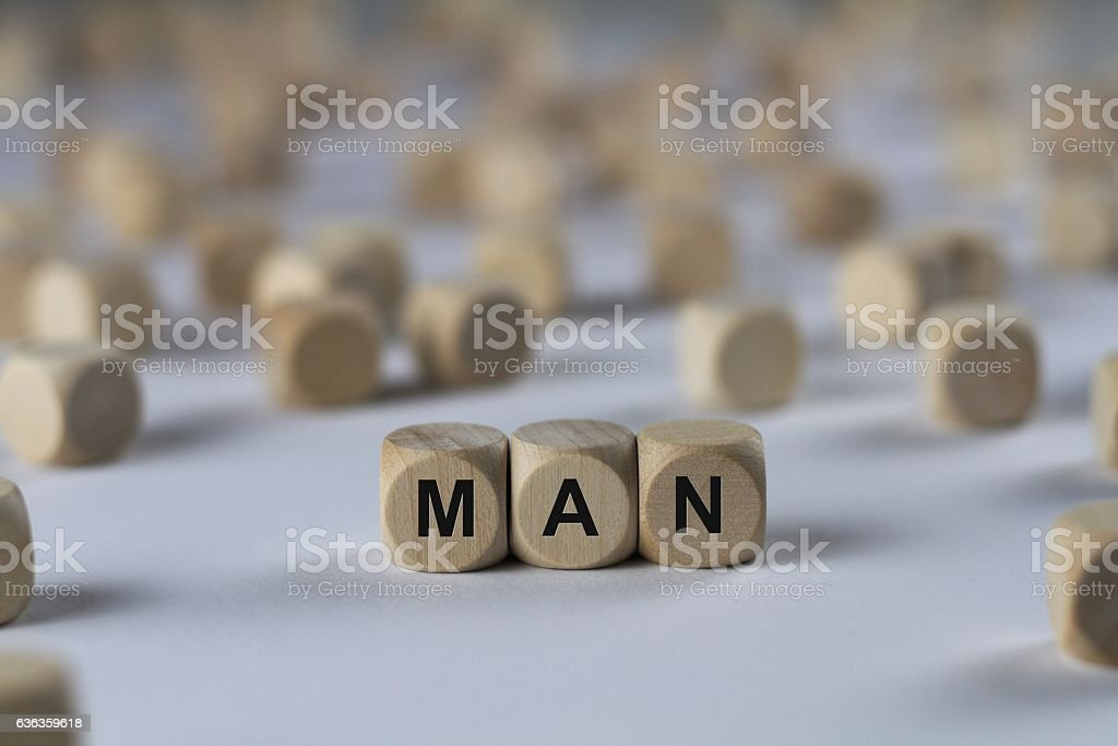 man - cube with letters, sign with wooden cubes stock photo