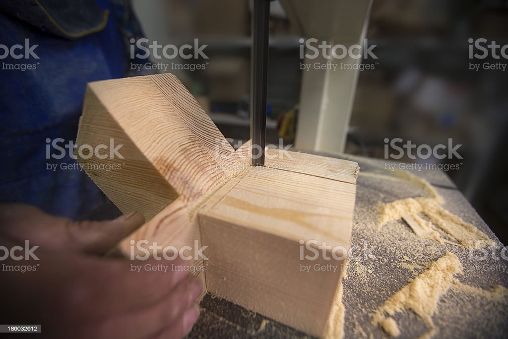 man cuts wood with a tool royalty-free stock photo