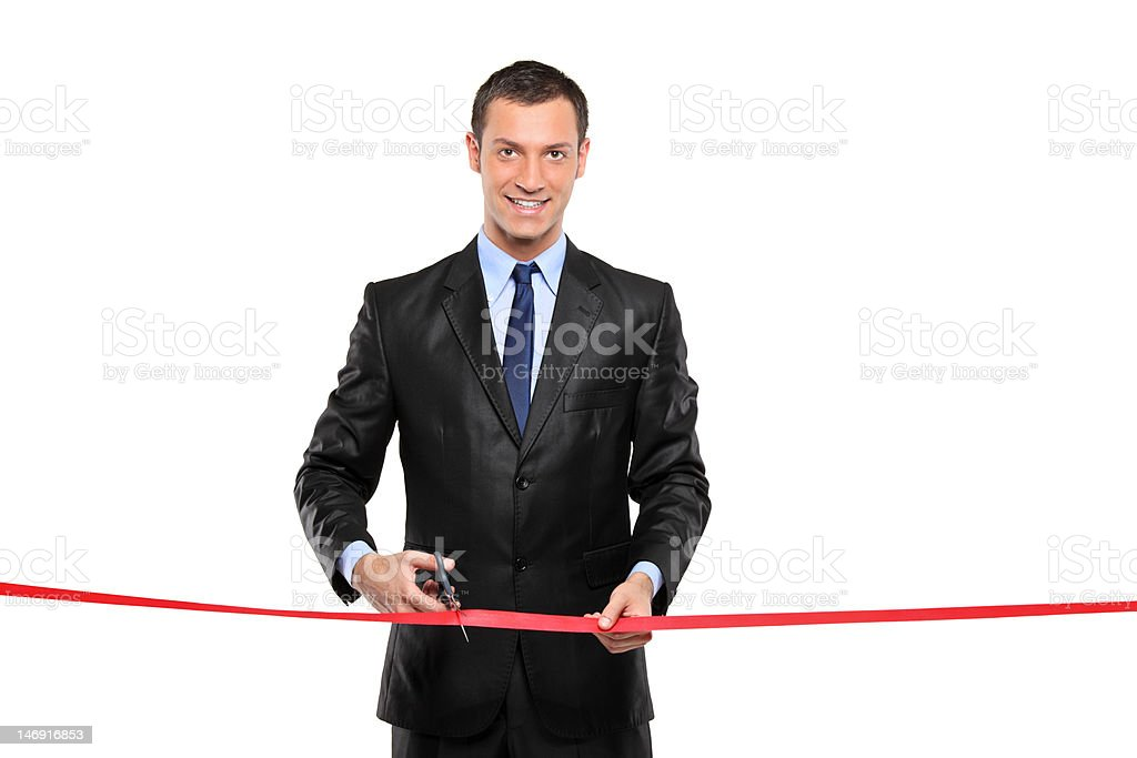 Man cutting a red ribbon, opening ceremony royalty-free stock photo
