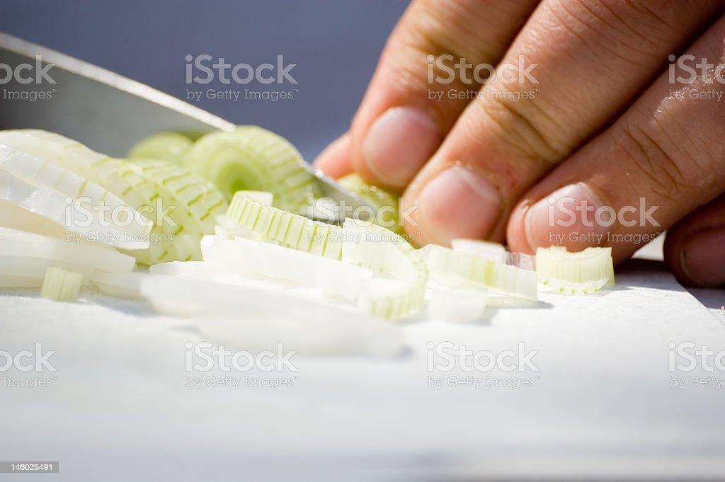 Man cutting an onion royalty-free stock photo