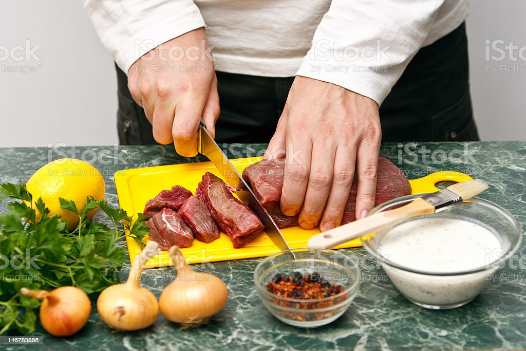Man cutting beef stock photo