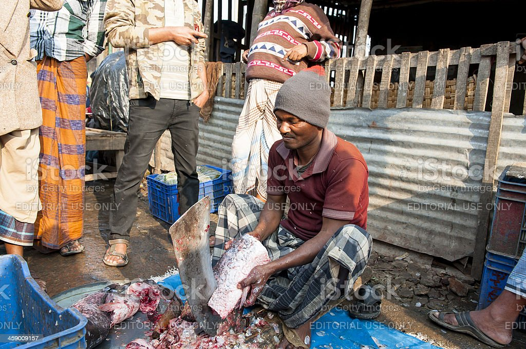 Man cutting fish in fishing market, Bangladesh stock photo