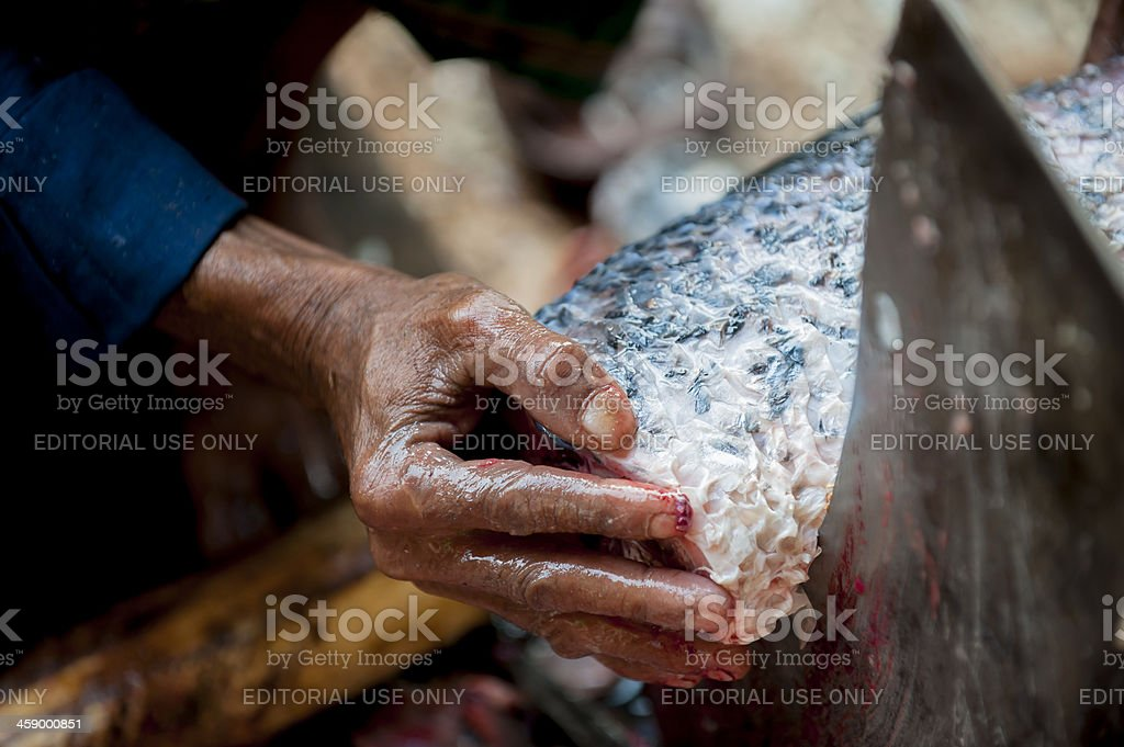 Man cutting fish on special knife stock photo