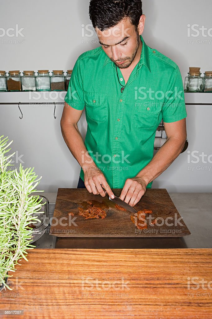 Man cutting food royalty-free stock photo