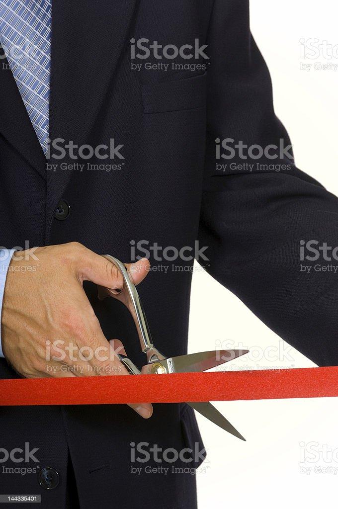 Man cutting red ribbon stock photo
