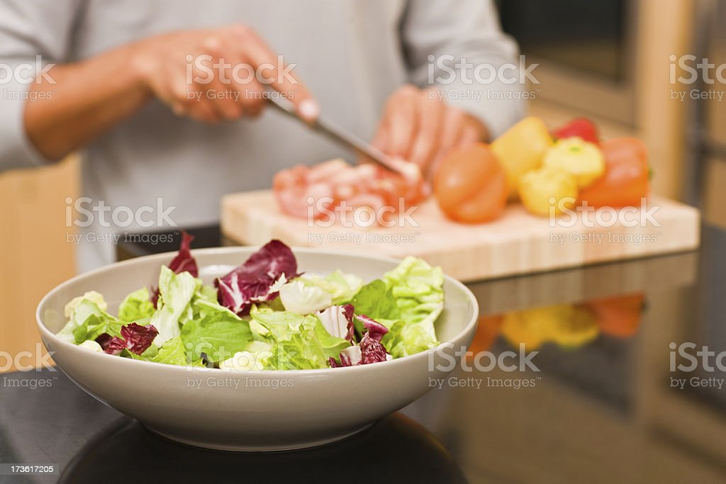Man cutting vegetables in kitchen royalty-free stock photo